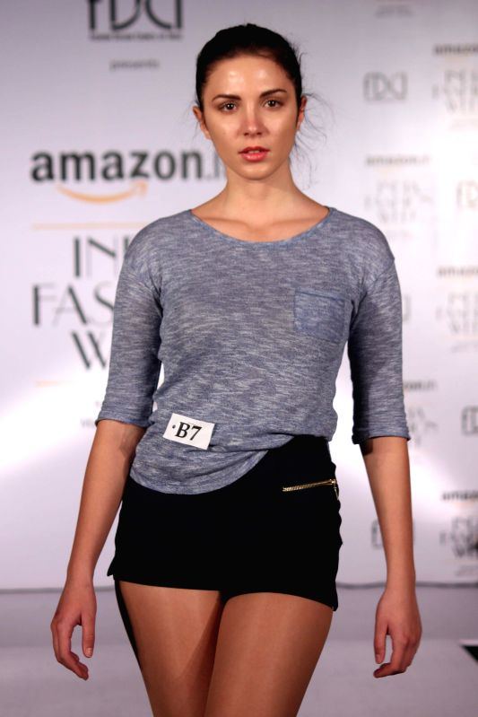 A model walks the ramp during the auditions for upcoming India Fashion Week Autumn Winter 2015, in New Delhi on Feb 18, 2015.