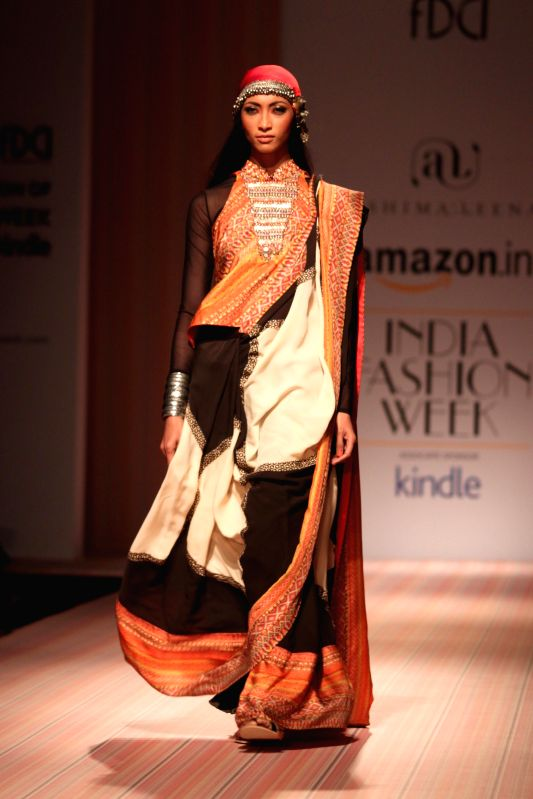 A model walks the ramp showcasing the creations of fashion designers Ashima and Leena at Amazon India Fashion Week in New Delhi on March 29, 2015.