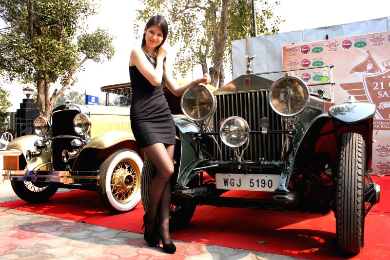 A model with a newly restored vintage cars during a press conference to announce 21 Gun Salute International Vintage Car Rally, in New Delhi on Feb 16, 2015.