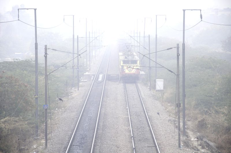 A number of trains get delayed as dense fog covers New Delhi.