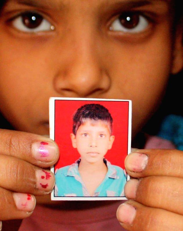 A photograph of a child who was run over by a bus on Mehrauli Badarpur Road near Ambedkar Nagar, New Delhi on March 13, 2015.