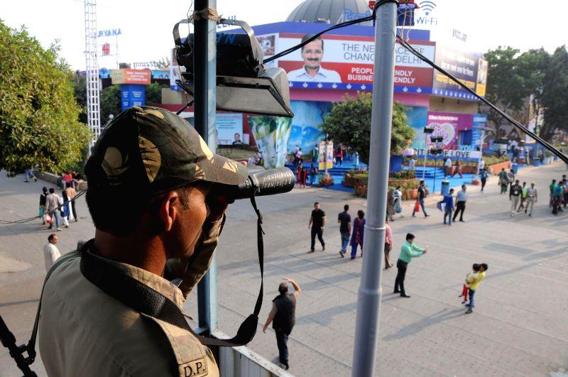 :New Delhi: A security personnel keep a tight vigil at Pragati Maidan after terror attack in Paris during 35th India International Trade Fair (IITF) -2015 in New Delhi on Nov 15, 2015. (Photo: ...
