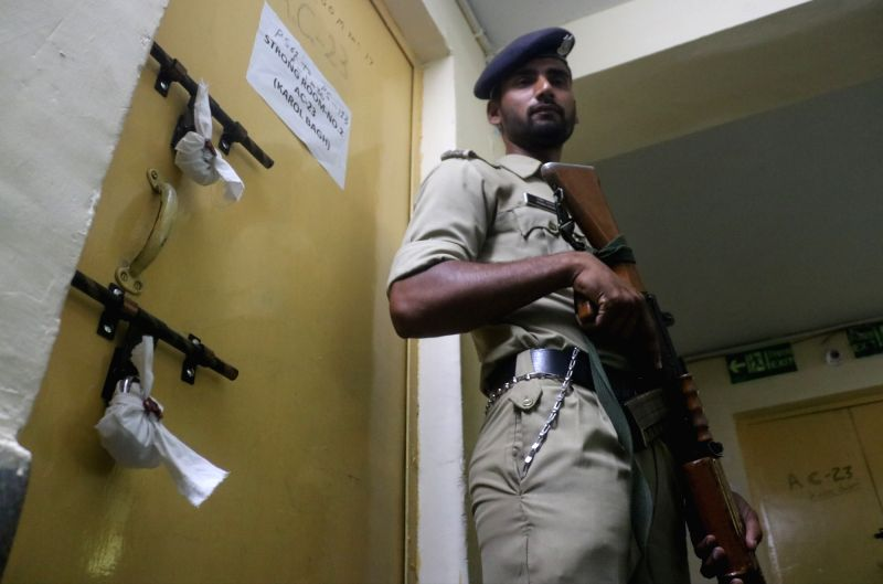 A security personnel stands guard outside an EVM strongroom ahead of the sixth phase of 2019 Lok Sabha elections