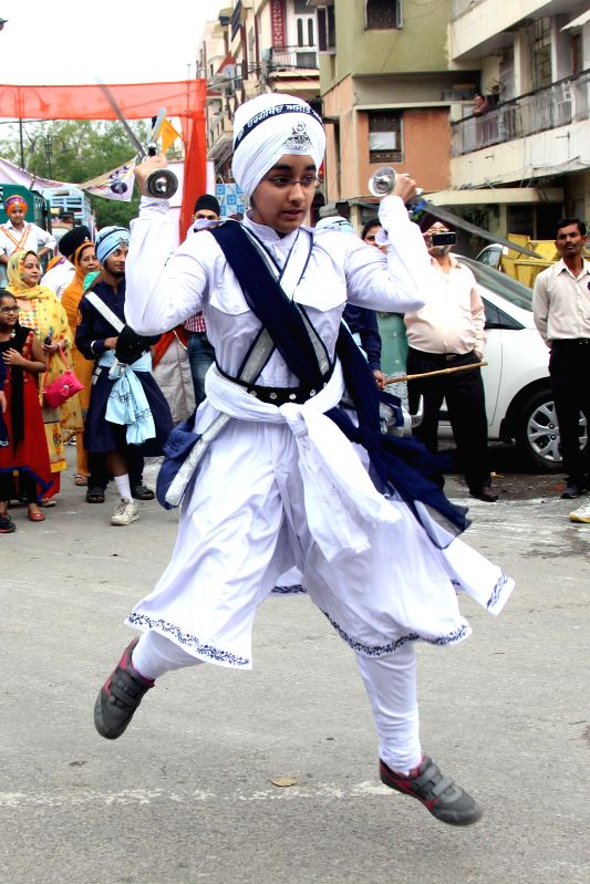 A Sikh demonstrates his `gatka skills` during Sikh Sajna Divas celebrations in New Delhi, on April 12, 2015.