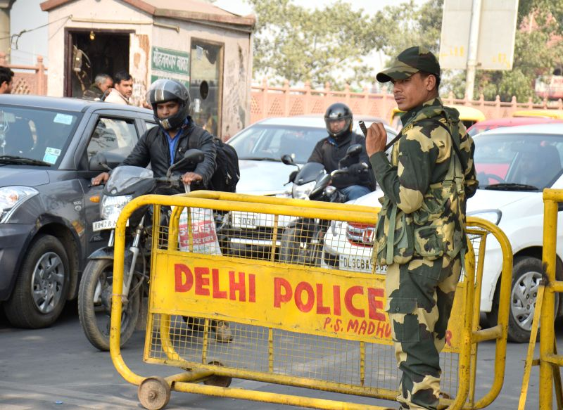 A soldier keeps a close watch on vehicular traffic movement at Delhi borders on the eve of Delhi assembly polls in New Delhi, on Feb 6, 2015.