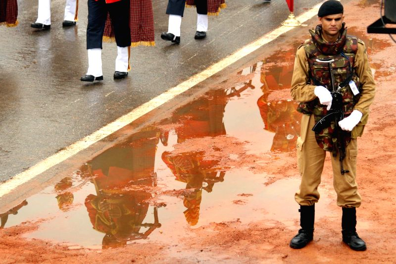 A soldier stands guard during  Republic Day celebrations at Rajpath in New Delhi, on Jan 26, 2015.