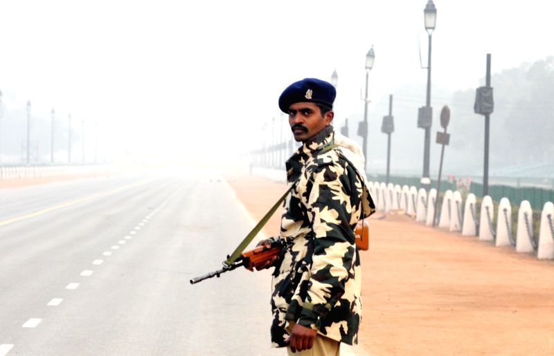 A soldier stands guard on Rajpath as security has been beefed-up in the area ahead of Republic Day in New Delhi, on Jan 12, 2015.