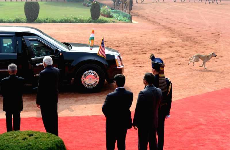 A stray dog in front of US President Barack Obama's armored vehicle - `The Beast` during his ceremonial reception at the Rashtrapati Bhawan in New Delhi, on Jan 25, 2015.