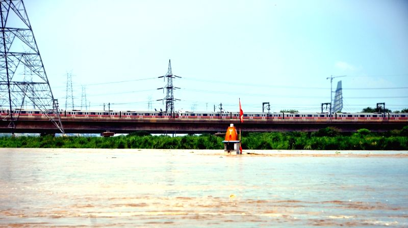 New Delhi: A temple partially submerged in the swollen Yamuna river that crossed the danger mark at 06.08 metres, in New Delhi on Aug 20, 2019. (Photo: IANS)
