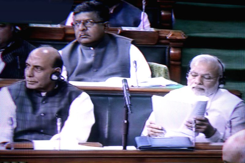 (A TV Grab) Prime Minister Narendra Modi and Union Home Minister Rajnath Singh during the budget session of the Parliament in New Delhi, on Feb 26, 2015. - Narendra Modi and Rajnath Singh