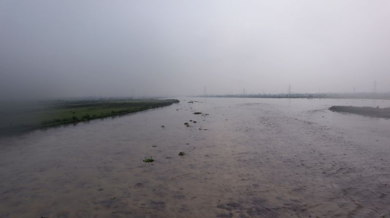 :New Delhi: A view of an overflowing Yamuna river, in New Delhi on July 28, 2018. Water released from Haryana's Hathnikund added to the continued rains have led the Yamuna river to breach its ...