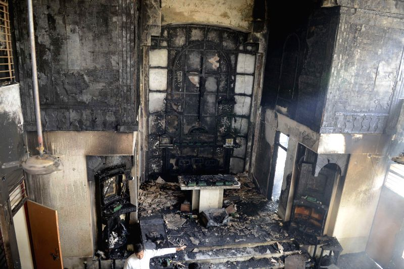 A view of charred sanctuary and altar at the St Sebastian's Church  in Delhi's Dilshad Garden  on Dec 1, 2014.