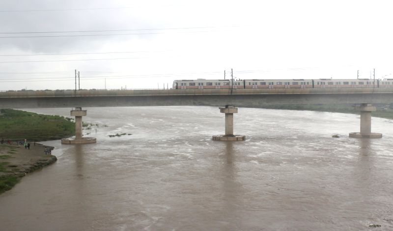 New Delhi: A view of the swollen Yamuna river after a rise in its water levels, in New Delhi on Aug 17, 2019. (Photo: Bidesh Manna/IANS)