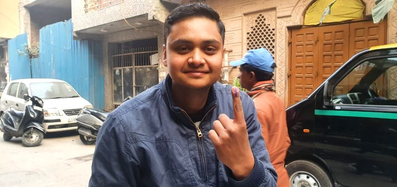New Delhi: A voter shows his inked finger after casting his vote for the Delhi Assembly elections 2020, on Feb 8, 2020. (Photo: IANS)