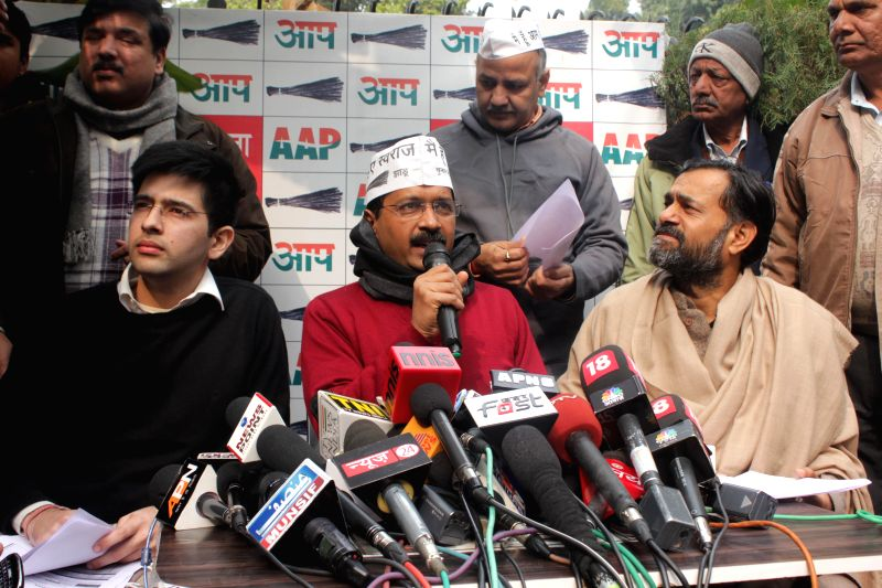 Aam Aadmi Party (AAP) leader Arvind Kejriwal addresses a press conference at North Avenue in New Delhi, on Jan 14, 2015. Also seen party leaders Yogendra Yadav, Sanjay Singh, Manish ... - Arvind Kejriwal, Yogendra Yadav and Sanjay Singh