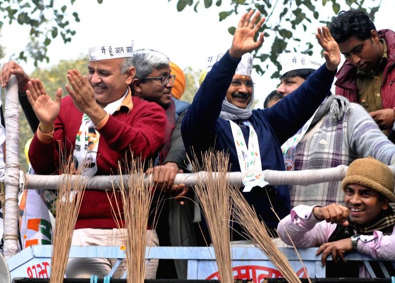 Aam Aadmi Party (AAP) leader Arvind Kejriwal during a roadshow ahead of filing his nominations papers for upcoming Delhi Assembly polls in New Delhi, on Jan 20, 2015. Also seen party ... - Sanjay Singh