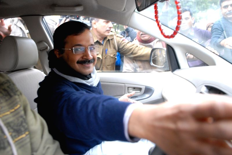 Aam Aadmi Party (AAP) leader Arvind Kejriwal proceeds to file his nomination papers for upcoming Delhi Assembly Polls in New Delhi, on Jan 21, 2015.