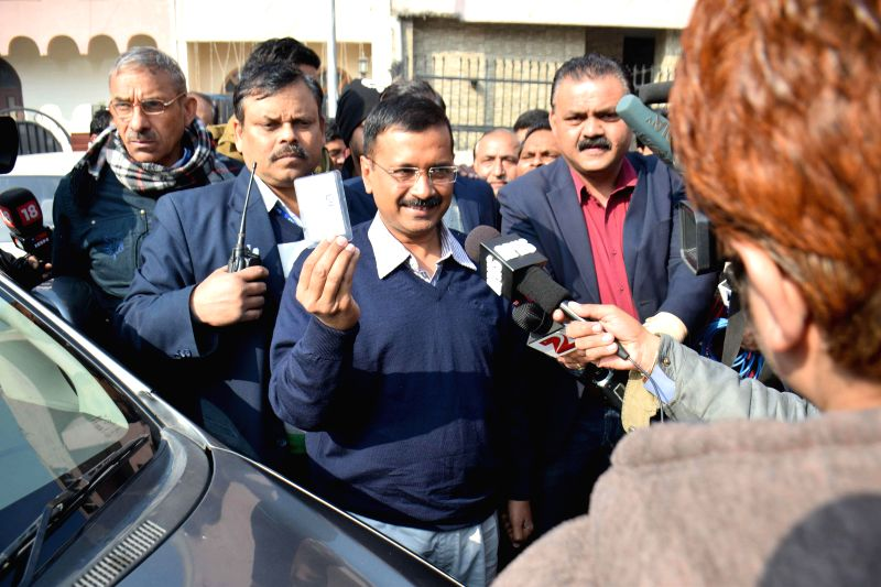 Aam Aadmi Party (AAP) leader Arvind Kejriwal arrives to cast his vote at a polling booth setup at SGTB Khalsa Girls Senior Secondary School during Delhi Assembly Polls, in New Delhi on Feb