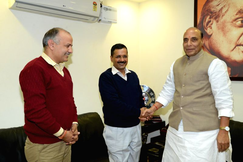 Aam Aadmi Party (AAP) leader Arvind Kejriwal and Manish Sisodia during a meeting with Union Home Minister Rajnath Singh in New Delhi, on Feb 11, 2015.