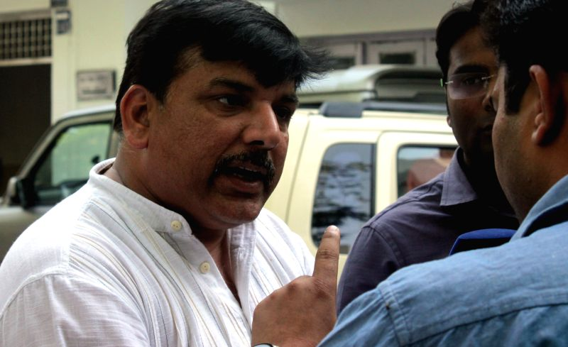 Aam Aadmi Party (AAP) leader Sanjay Singh during a press conference regarding a farmer's suicide at an AAP rally in New Delhi on April 22, 2015. - Sanjay Singh
