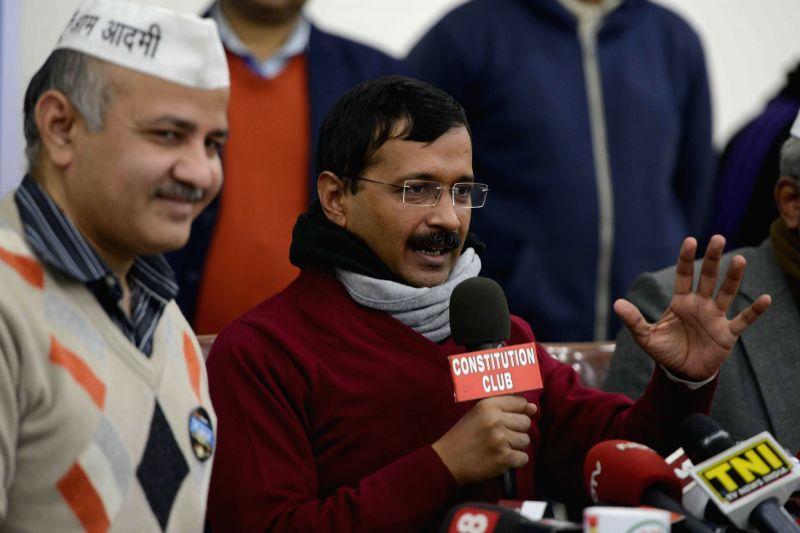 Aam Aadmi Party (AAP) leaders Arvind Kejriwal and Manish Sisodia address a press conference in New Delhi, on Jan 2, 2015. - Arvind Kejriwal