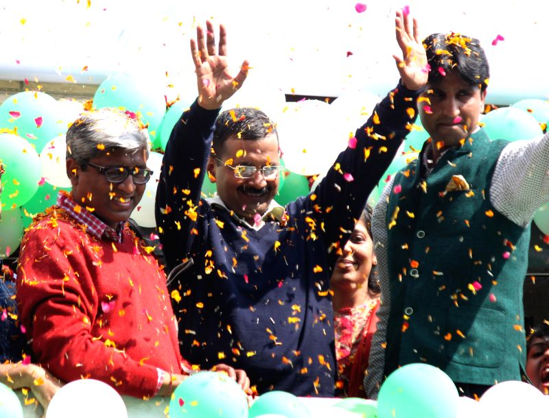 Aam Aadmi Party (AAP) leaders Arvind Kejriwal, Ashutosh and Kumar Vishwas celebrate party's performance in the recently concluded Delhi Assembly Polls in New Delhi, on Feb 10, 2015. - Arvind Kejriwal