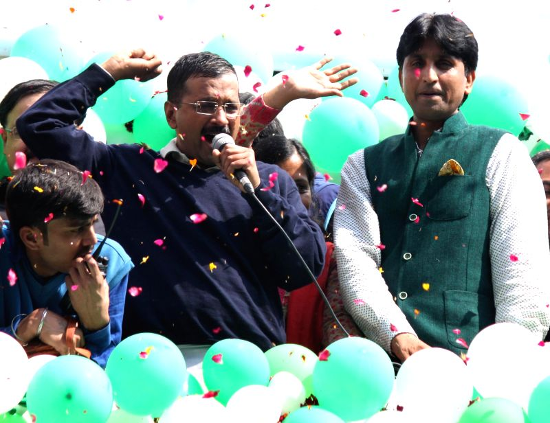 Aam Aadmi Party (AAP) leaders Arvind Kejriwal and Kumar Vishwas celebrate party's performance in the recently concluded Delhi Assembly Polls in New Delhi, on Feb 10, 2015. - Arvind Kejriwal