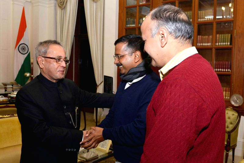 Aam Aadmi Party (AAP) leaders Arvind Kejriwal and Manish Sisodia call on President Pranab Mukherjee after winning the recently concluded Delhi Assembly Polls in New Delhi, on Feb 11, 2015.