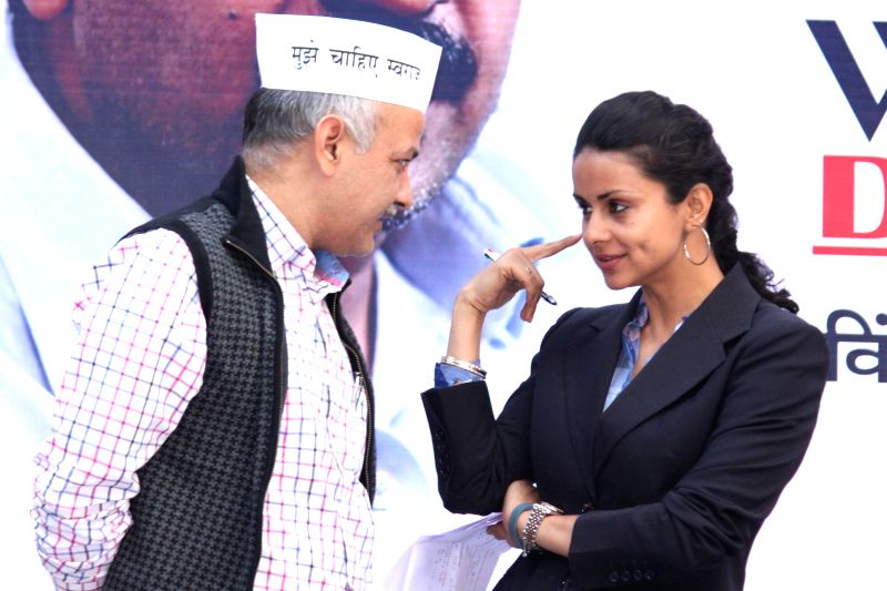 Aam Aadmi Party (AAP) leaders Manish Sisodia and Gul Panag during party`s women wing programme in New Delhi on Nov 26, 2014.