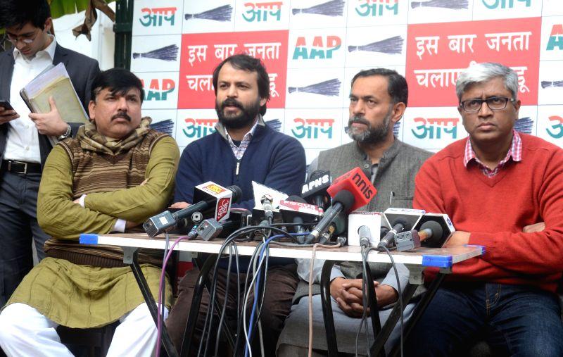 Aam Aadmi Party (AAP) leaders Sanjay Singh, Ashish Khaitan, Yogendra Yadav and Ashutosh during a press conference in New Delhi on Feb. 2, 2015. - Sanjay Singh and Yogendra Yadav