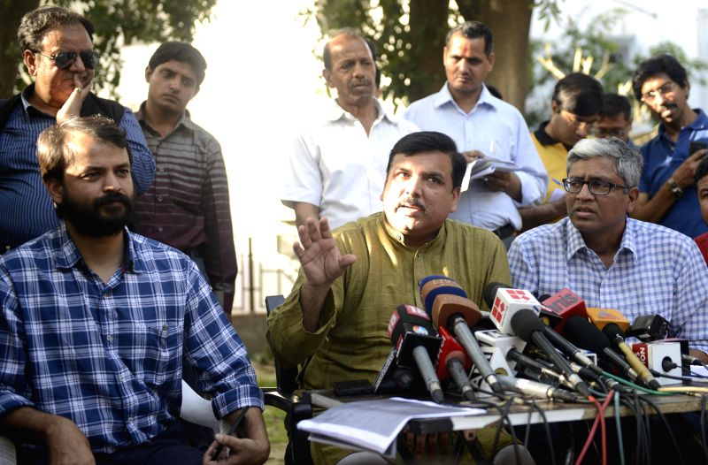 Aam Aadmi Party (AAP) leaders Sanjay Singh, Ashish Khaitan and Ashutosh address a press conference in New Delhi, on March 27, 2015. - Sanjay Singh