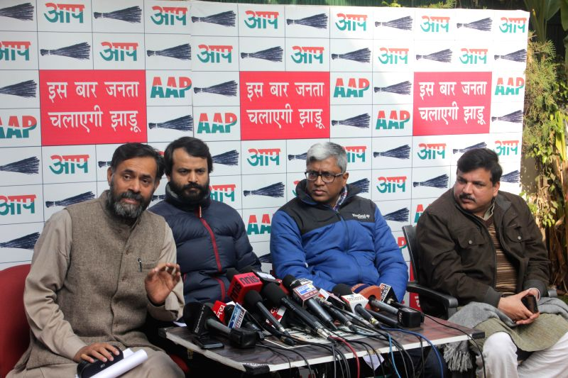 Aam Aadmi Party (AAP) leaders Yogendra Yadav, Ashish Khaitan, Ashutosh and Sanjay Singh during a press conference in New Delhi, on Dec 26, 2014. - Yogendra Yadav and Sanjay Singh