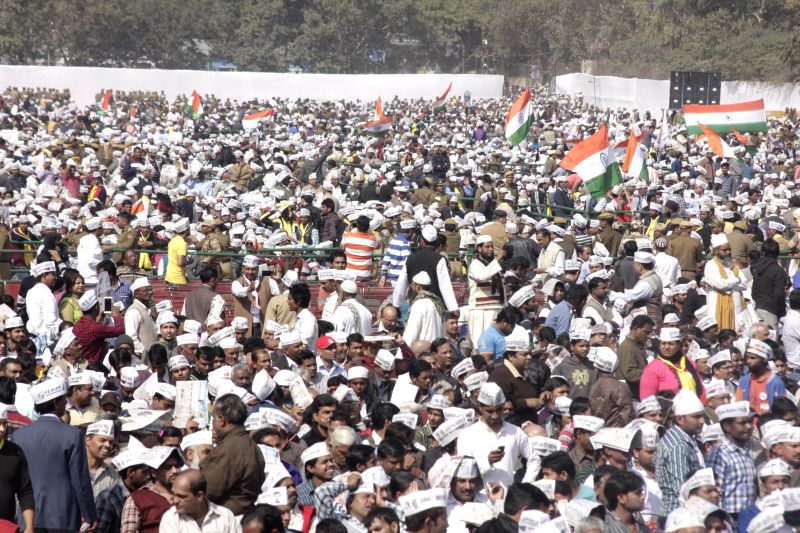 Aam Aadmi Party (AAP) supporters at the swearing-in ceremony of Delhi Chief Minister Arvind Kejriwal at Ramlila Maidan in New Delhi, on Feb 14, 2015. - Arvind Kejriwal