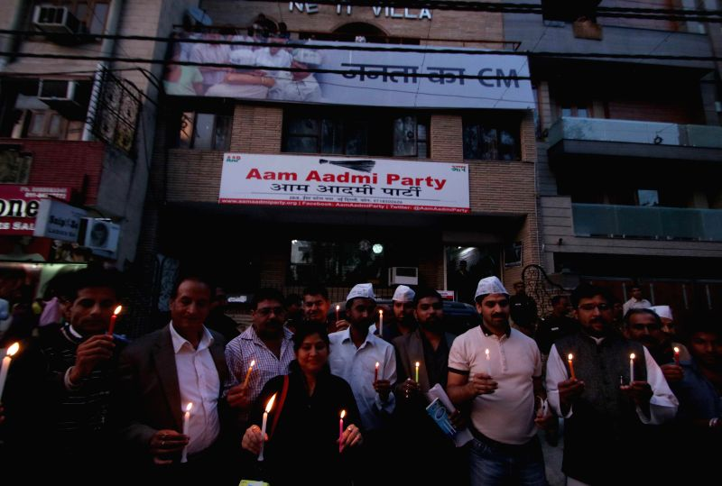 Aam Aadmi Party (AAP) workers hold a candlelight vigil in front of party's Patel Nagar office in New Delhi, on March 11, 2015.