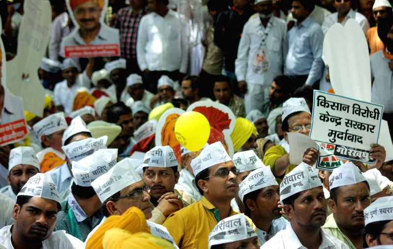 Aam Aadmi Party (AAP) workers participate in a party rally organised to protest against the land acquisition ordinance at Jantar Mantar in New Delhi, on April 22, 2015.