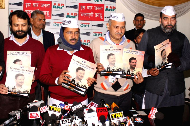 Aam Aadmi Party chief Arvind Kejriwal and other AAP leaders release Aam Aadmi party manifesto for upcoming Delhi assembly elections, in New Delhi on Jan 31, 2015. - Arvind Kejriwal