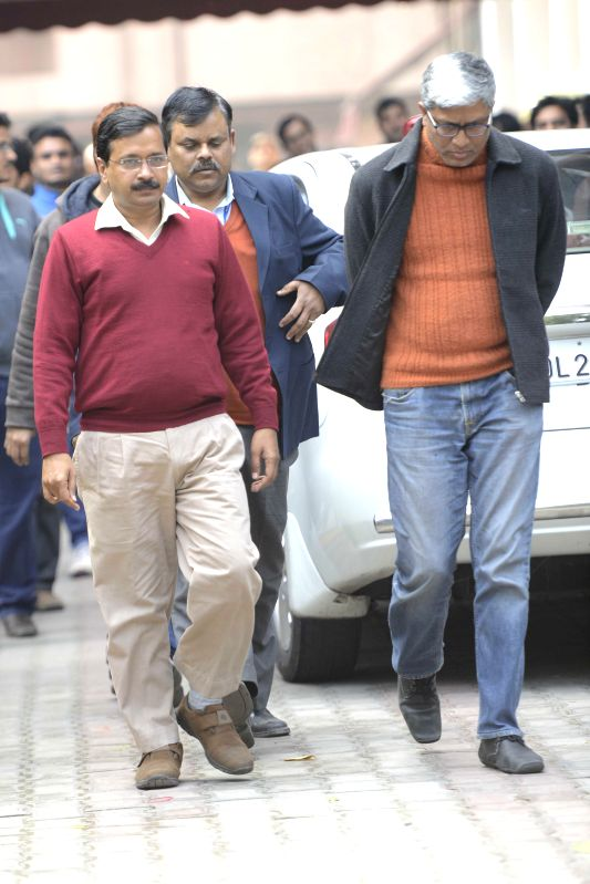 Aam Aadmi Party convener Arvind Kejriwal and Ashutosh coming out after the meeting Election Commission in New Delhi on Feb. 4, 2015. - Arvind Kejriwal