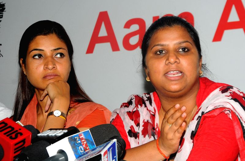Aam Aadmi Party MLA Rakhi Birla with Alka Lamba during a press conference in New Delhi on April 4, 2015.