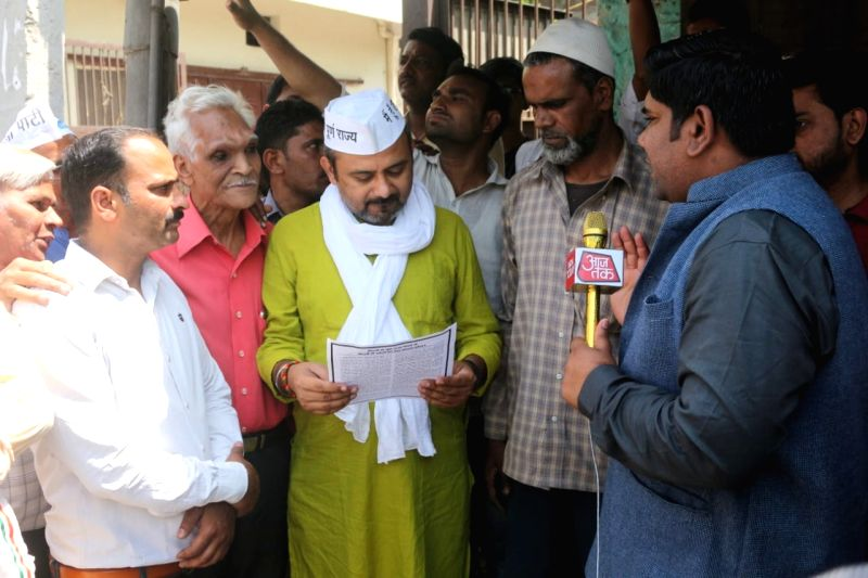 New Delhi: AAP leader Dilip Pandey during election campaign in New Delhi on April 10, 2019.