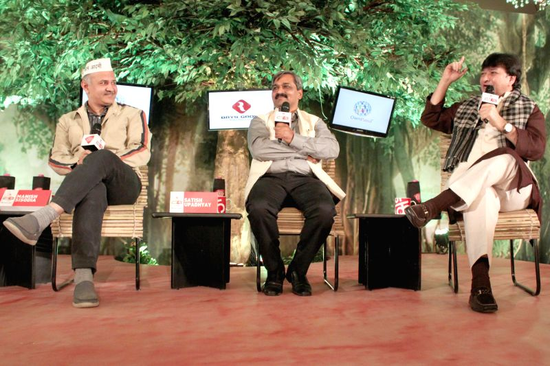 AAP leader Manish Sisodia, Delhi BJP chief Satish Upadhyay and Congress leader Haroon Yusuf during a programme organised by Aaj Tak news channel in New Delhi, on Dec 13, 2014. - Satish Upadhyay