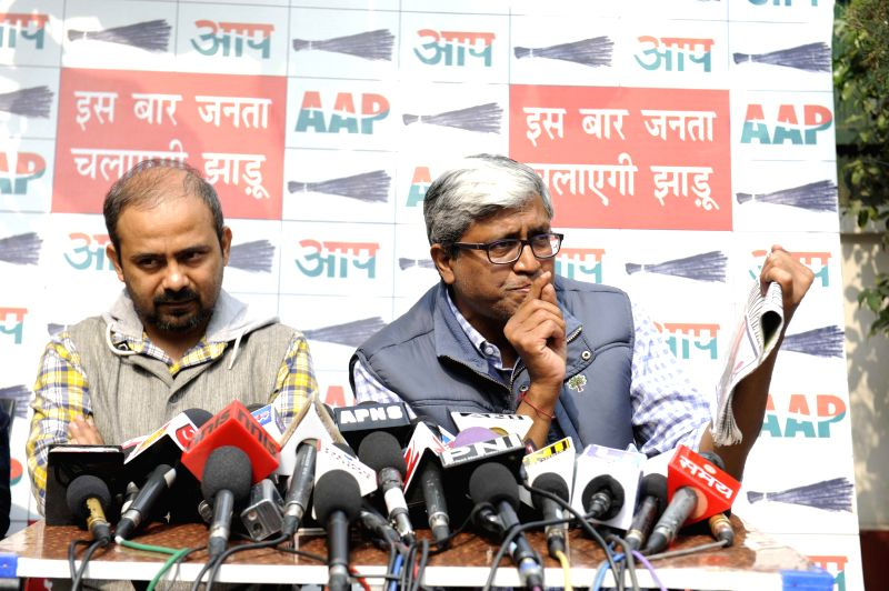 AAP leaders Dilip Pandey and Ashutosh addresses a press conference in New Delhi, on Feb 18, 2015. - Dilip Pandey
