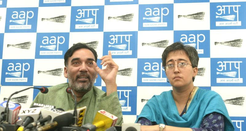 New Delhi: AAP MLA and Delhi convener Gopal Rai addresses a press conference in New Delhi on May 19, 2017. Also seen AAP leader Atishi Marlena. - Gopal Rai