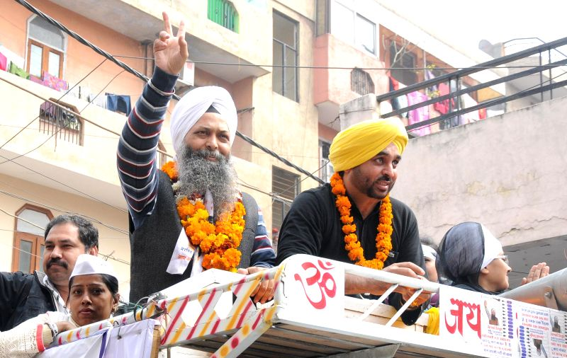 AAP MP from Punjab Bhagwant Mann campagning in favor of AAP candidate from Rajouri Garden Jarnail Singh during a road show for the upcoming Delhi Assembly Election at Rajouri Garden in ...