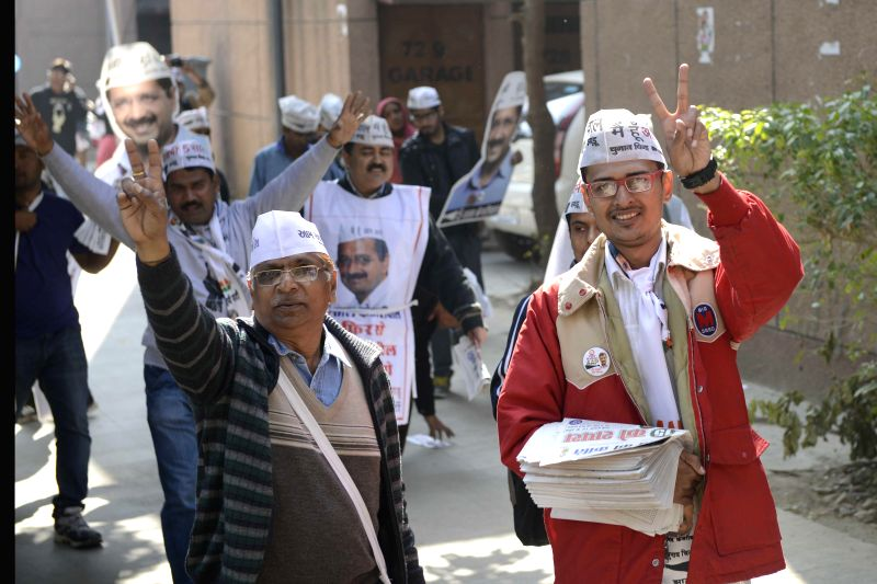 AAP supporters campaign for the party in New Delhi on Feb. 5, 2015.