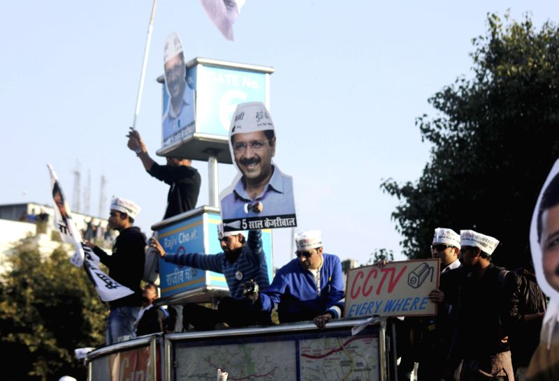AAP supporters campaign for the party at Connaught Place in New Delhi on Feb. 5, 2015.