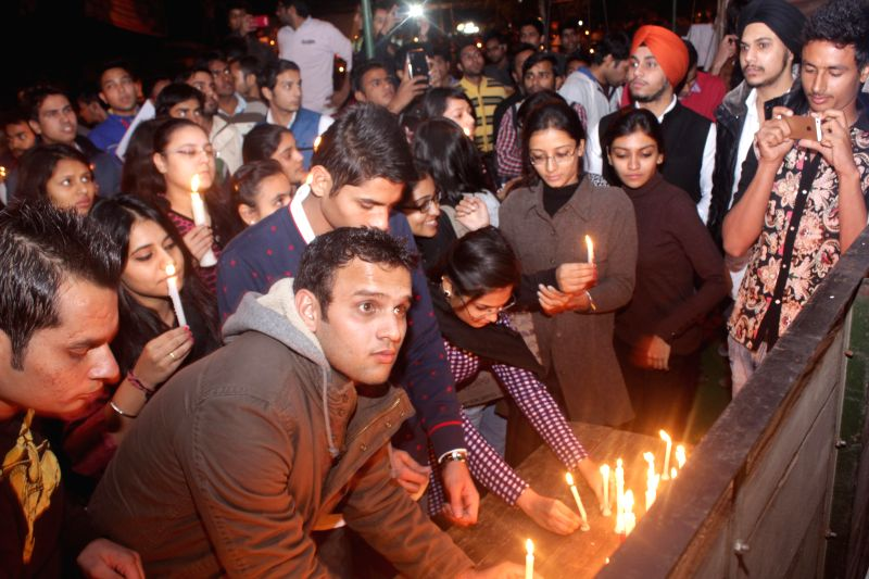 ABVP activists participate in a candlelight vigil to condemn the 2012 Nirbhaya gangrape in New Delhi, on Dec 16, 2014.