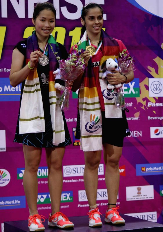 Ace shuttler Saina Nehwal with Thai badminton player Ratchanok Intanon after winning the women's singles title of the India Open Superseries at the Siri Fort Sports Complex in New Delhi, ...