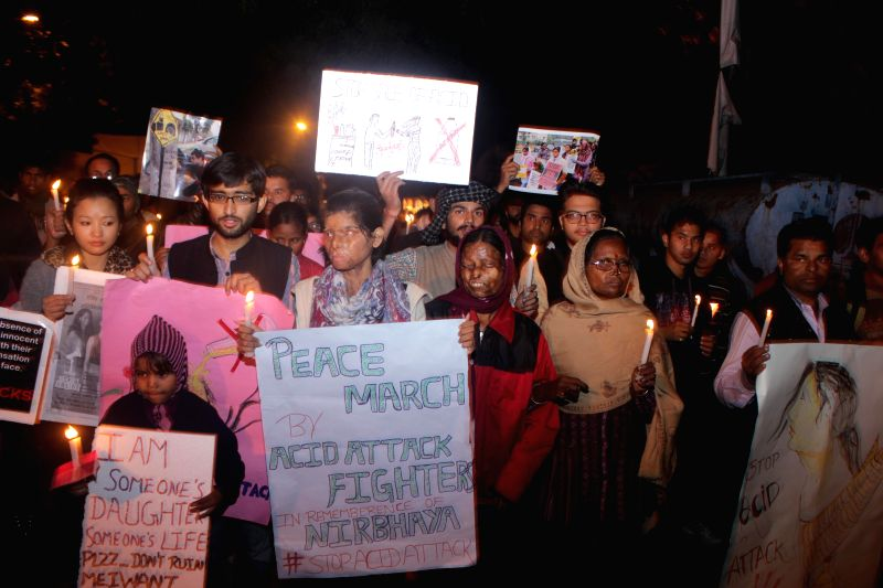 Acid attack victims participate in a candlelight vigil to condemn the 2012 Nirbhaya gangrape in New Delhi, on Dec 16, 2014.