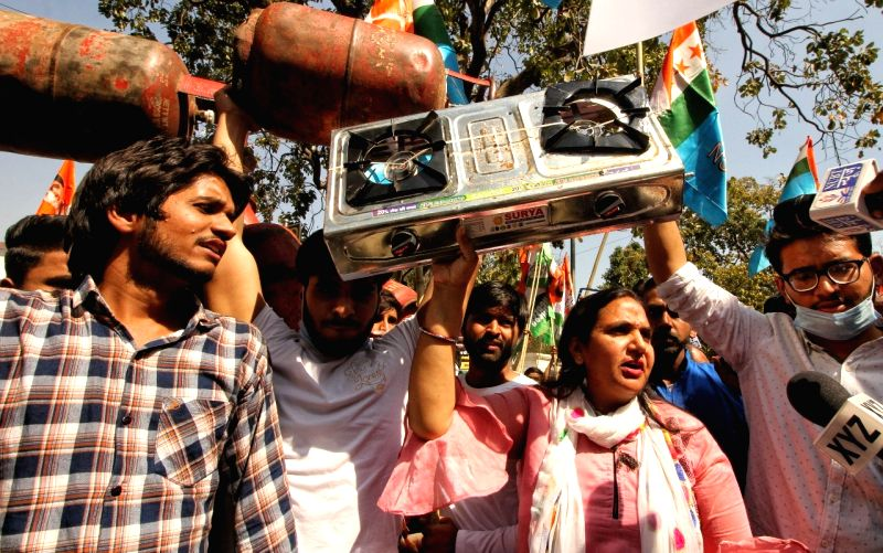 New Delhi: Activist of Indian Youth Congress (IYC) protest outside Shastri bhawan against price hike of LPG Gas and Petrol in new Delhi. (Photo:IANS/Wasim Sarvar)