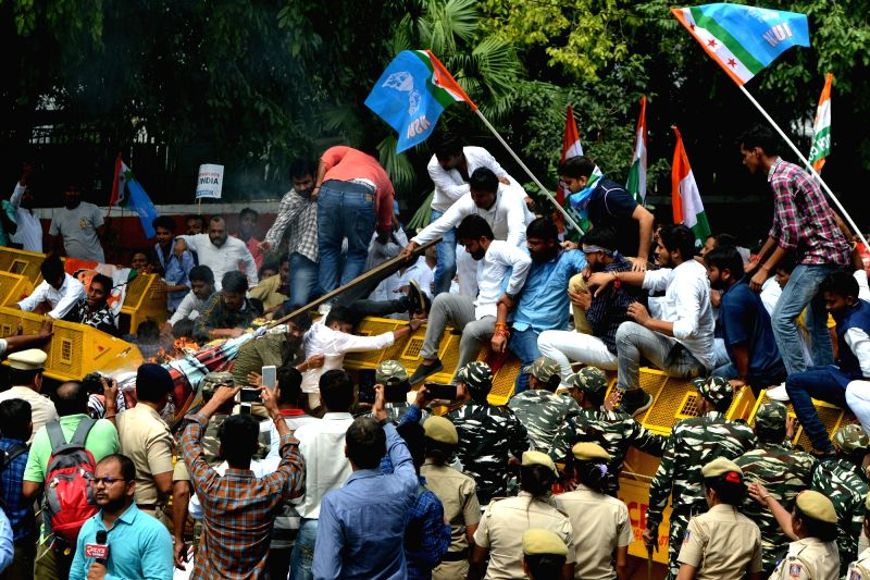 New Delhi: Activists of National Students' Union of India (NSUI) - the students wing of the Congress - stage a demonstration against the arrest of senior party leader D.K. Shivakumar, in New Delhi on Sep 4, 2019. (Photo: IANS)